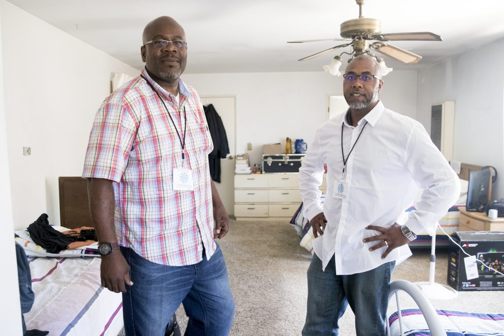 From left Cortez Chandler and Yusef-Andre Wiley in residents' rooms at Pathway House in Los Angeles, California, photographed on Tuesday, July 19, 2016. (James Buck / Yes!)