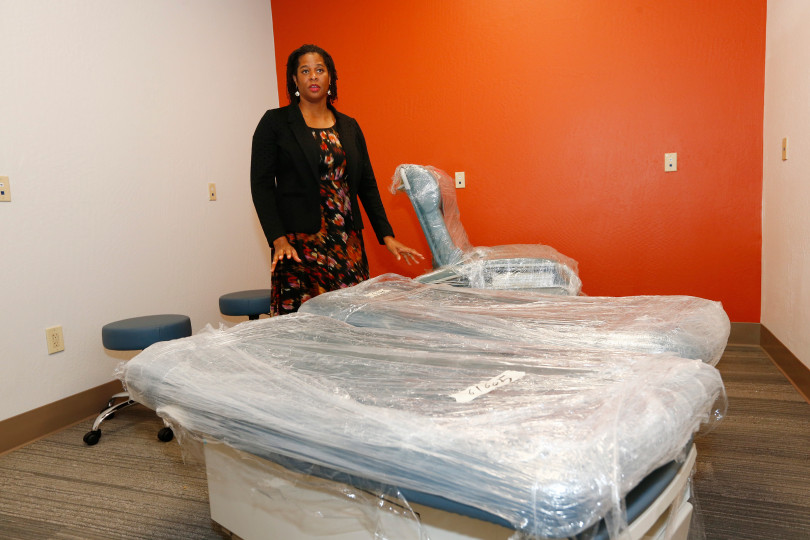 Alma Burrell, Roots South Bay manager, shows the brand new physician's room to visitors at the Roots Community Health Center in San Jose, Calif., on Friday, April 28, 2017. The non-profit, which began in Oakland in 2008, is dedicated to providing comprehensive healthcare, mental health, and other health services that emphasizes community empowerment. (Gary Reyes/ Bay Area News Group)
