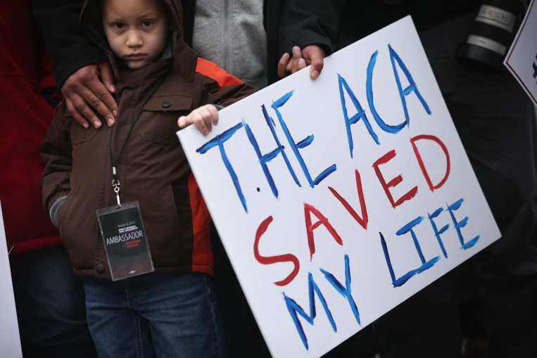 WASHINGTON, DC - MARCH 04: Five-year-old James Cook of Cleveland, Ohio, participates in a rally to support the Affordable Care Act in front of the U.S Supreme Court March 4, 2015 in Washington, DC. The Supreme Court was scheduled to hear oral arguments in the case of King v. Burwell that could determine the fate of health care subsidies for as many as eight million people. (Photo by Alex Wong/Getty Images) ORG XMIT: 541152493 ORG XMIT: CST1503040935521907